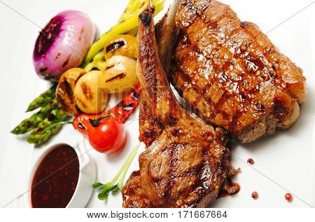 Various types meat roasted with vegetable closeup Beef roasted potato and vegetables Lamb chops with garnish carved roast beef and vegetables grilled ribs shish kebab mix