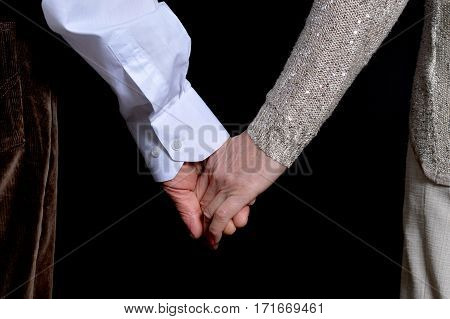 woman and man hands against black background