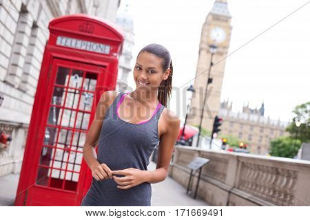 a happy young fitness woman in london