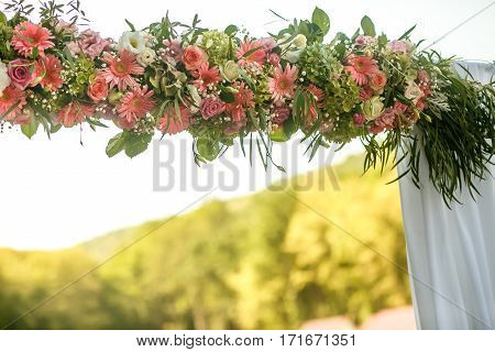 The wedding archway with pink beautiful flowers