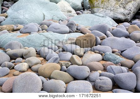 pattern of stones and pebbles on a seaside beach