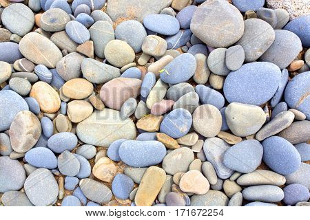 blue, grey and orange stones with white lines