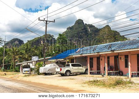 Krabi, Thailand. Streets Of The Suburb, Cars And Buildings. .