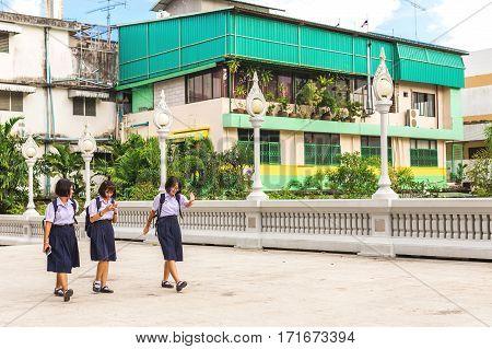 Krabi Town Thailand - December 16 2016: Students going home after school near Wat Kaew temple.