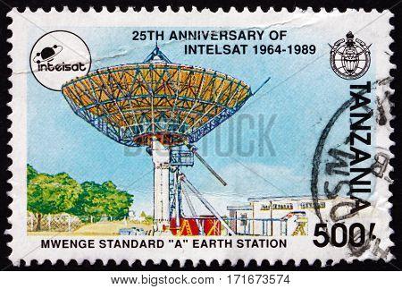 TANZANIA - CIRCA 1991: a stamp printed in Tanzania shows Mwenge standard A Earth station 25th anniversary of Intelsat circa 1991