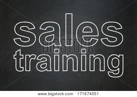 Marketing concept: text Sales Training on Black chalkboard background