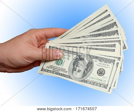 Money in hand dollars on blue background