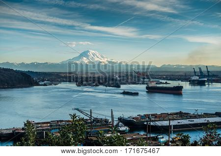 A view of moored boats in the Port of Tacoma with Mount Rainier in the distance.