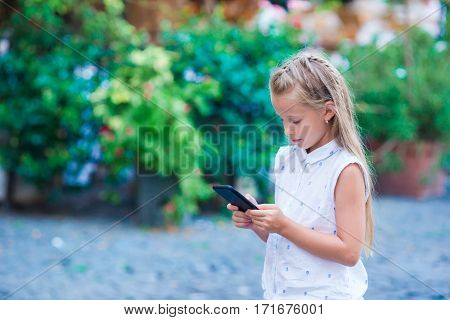 Adorable little girl in europe with cellphone