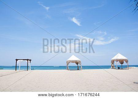 Sandy beach and blue sky in Kuta, Bali, Indonesia