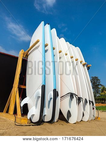 Weligama, Sri Lanka - January 12 2017: Set Of Different Color Surf Boards In A Stack By Ocean.weliga