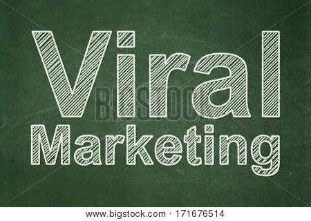 Marketing concept: text Viral Marketing on Green chalkboard background