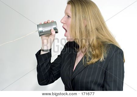Woman Yelling Into A Can Telephone