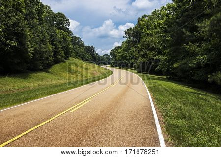View of the Natchez Trace Parkway in Mississippi; Concept for travel in America and road trip in America