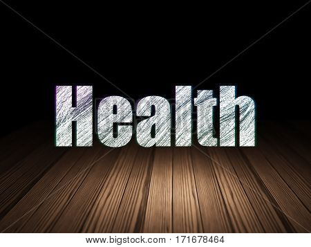 Healthcare concept: Glowing text Health in grunge dark room with Wooden Floor, black background
