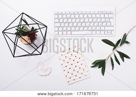 White feminine tabletop flatlay. Home office decor objects.