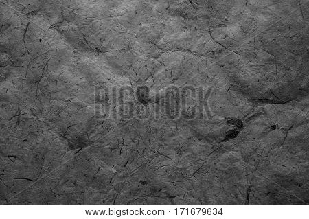 Abstract gray texture. Dark paper background. Abstract  background and texture for designers. Old vintage recycled paper. Black abstract background. Dark rough paper.