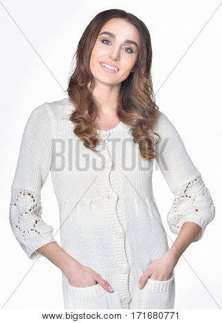 portrait of beautiful woman posing against white