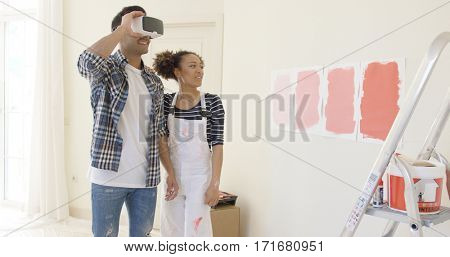 Couple uses virtual reality glasses to choose