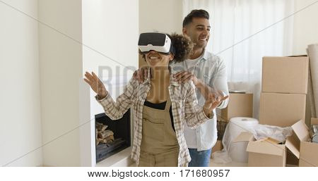Happy young couple doing Virtual tour in new apartment