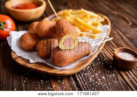 Corndogs With Fries, Ketchup And Mustard