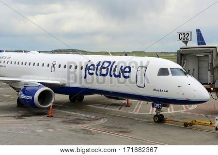 BOSTON - MAY. 6, 2015: Jetblue Airways Embraer 190 taxiing at Boston Logan International Airport, Boston, Massachusetts, USA.