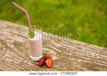 Delicious strawberry smoothie close-up. Fresh cold strawberry smoothies with fresh fruits. Strawberry smoothies strawberry detox strawberry milkshake.