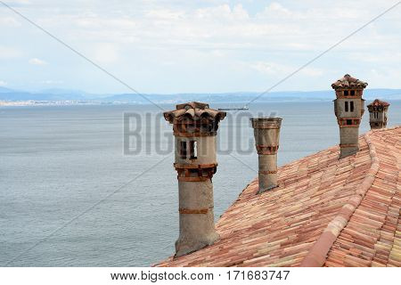Roof tiles and chimneys on Duino castle.