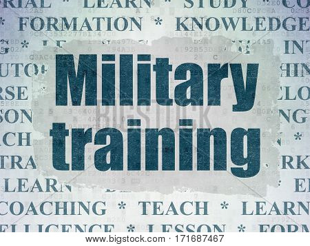 Studying concept: Painted blue text Military Training on Digital Data Paper background with   Tag Cloud