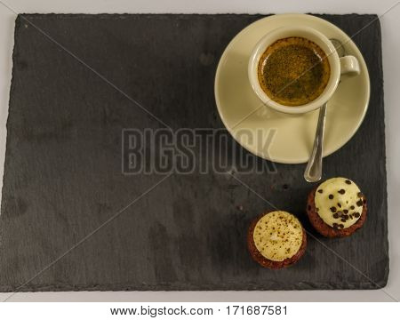 top view on two sweet cupcakes strawberry and creamy chocolate background delicious aroma of black coffee