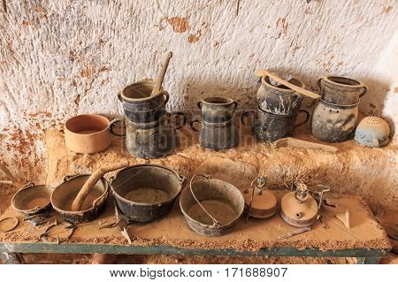 Ceramic pots and jars in interior of residential caves of troglodyte in Matmata, Tunisia, Africa