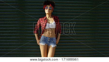 Sexy african american young woman leaning on wall