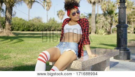 Sexy african american girl sitting on bench