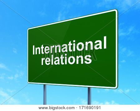 Political concept: International Relations on green road highway sign, clear blue sky background, 3D rendering