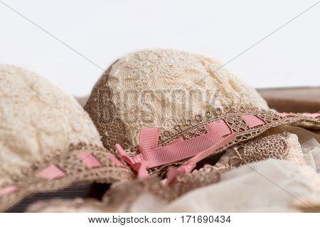 Beige set of lacy underwear on wooden background