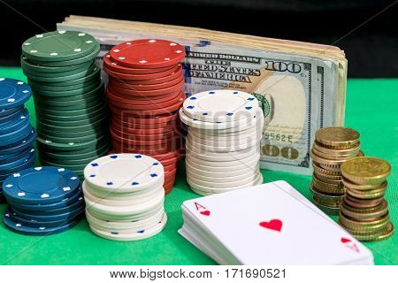 four aces with dollars and chips on green cloth