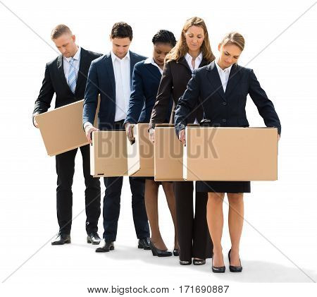 An Unhappy Businesspeople Standing With Cardboard Boxes On White Background