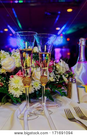Champagne Glasses On Dining Table In Restaurant