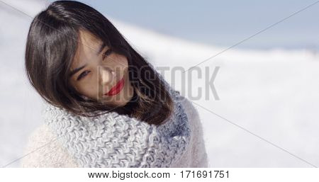 Happy cute asian girl enjoying her winter time