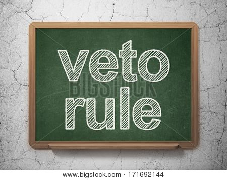 Political concept: text Veto Rule on Green chalkboard on grunge wall background, 3D rendering