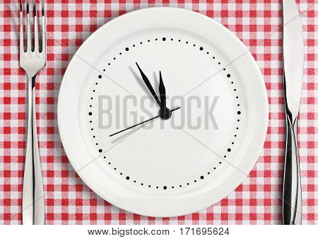Blank clock on plate , time concept