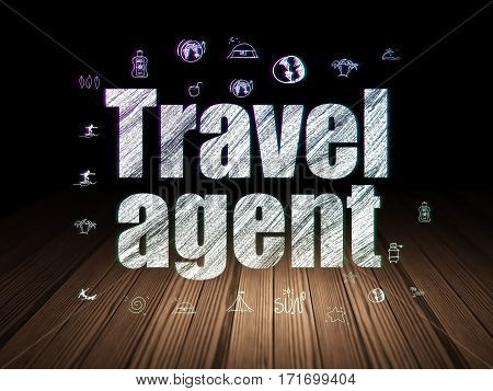 Travel concept: Glowing text Travel Agent,  Hand Drawn Vacation Icons in grunge dark room with Wooden Floor, black background