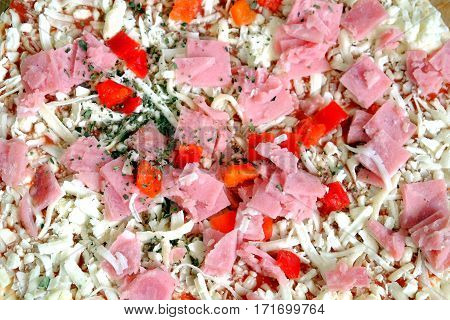 Raw unready pizza as background top view closeup