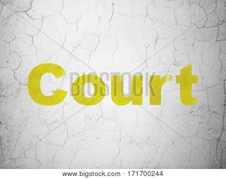 Law concept: Yellow Court on textured concrete wall background