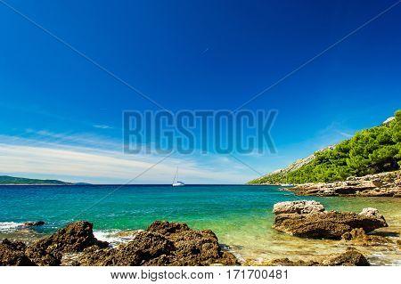 Beautiful sea view on island Brac in Croatia with yacht