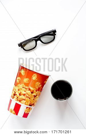 concept of watching movies with popcorn top view on white background