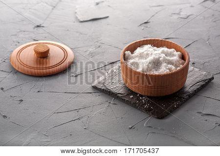 salt on black stone and gray background