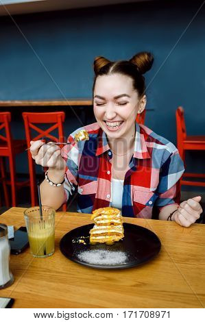 beatiful young woman eat desert in caffe.