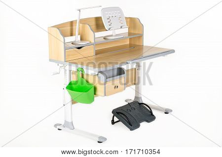 Wooden school table green basket desk lamp and support under legs on the white isolated background.