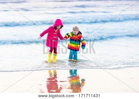 Kids On North Sea Beach In Winter